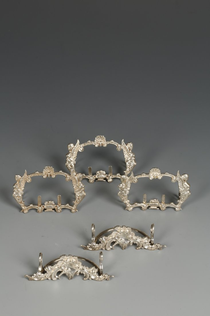 A SET OF THREE EDWARDIAN MENU CARD HOLDERS of shaped