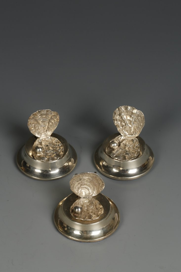 A SET OF THREE EDWARDIAN MENU CARD HOLDERS modelled in