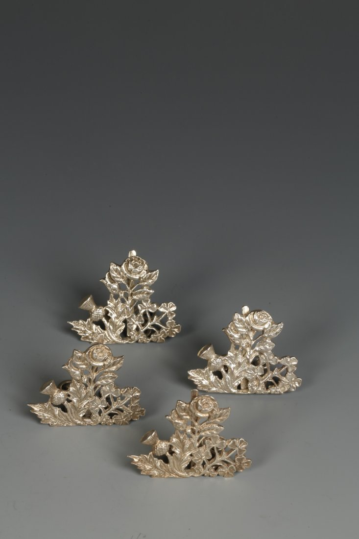 A SET OF FOUR LATE VICTORIAN MENU CARD HOLDERS modelled