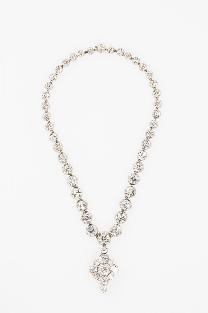 AN IMPORTANT DIAMOND RIVIERE NECKLACE AND PENDANT, the