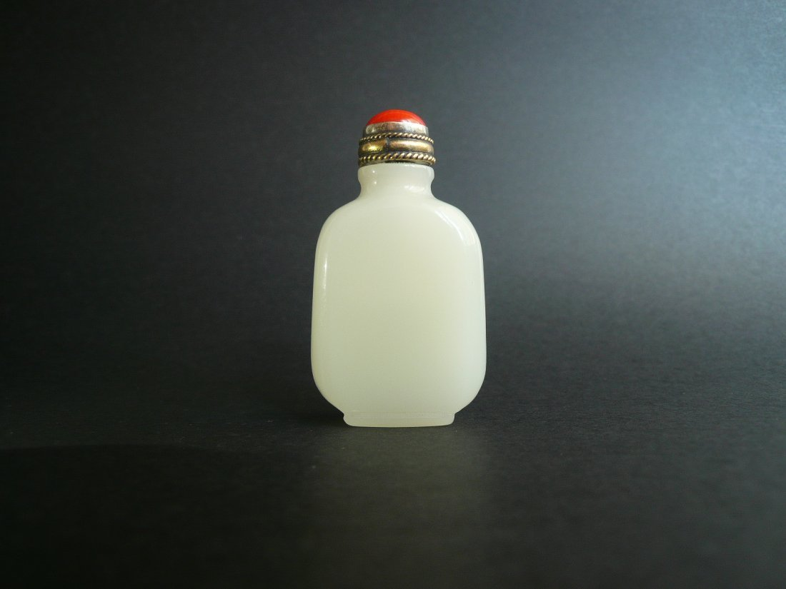 A Qing Dynasty White Jade Snuff Bottle