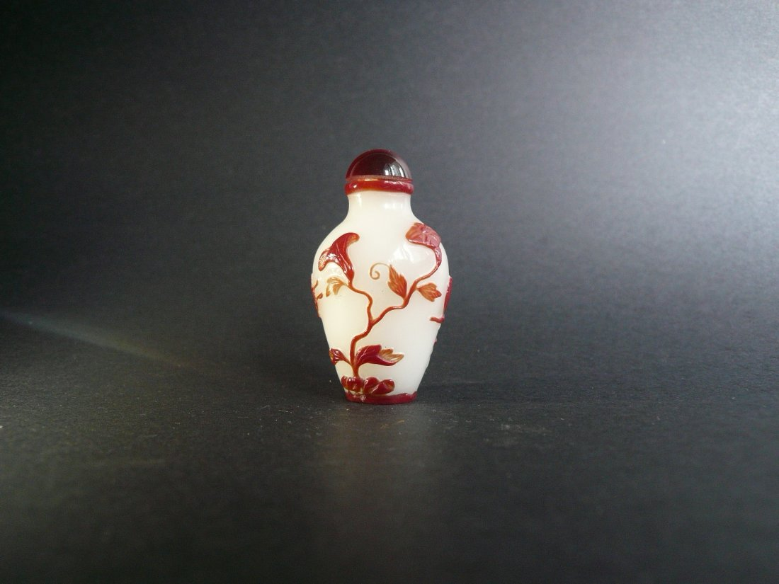 A Qing Dynasty Glass Overlay Snuff Bottle