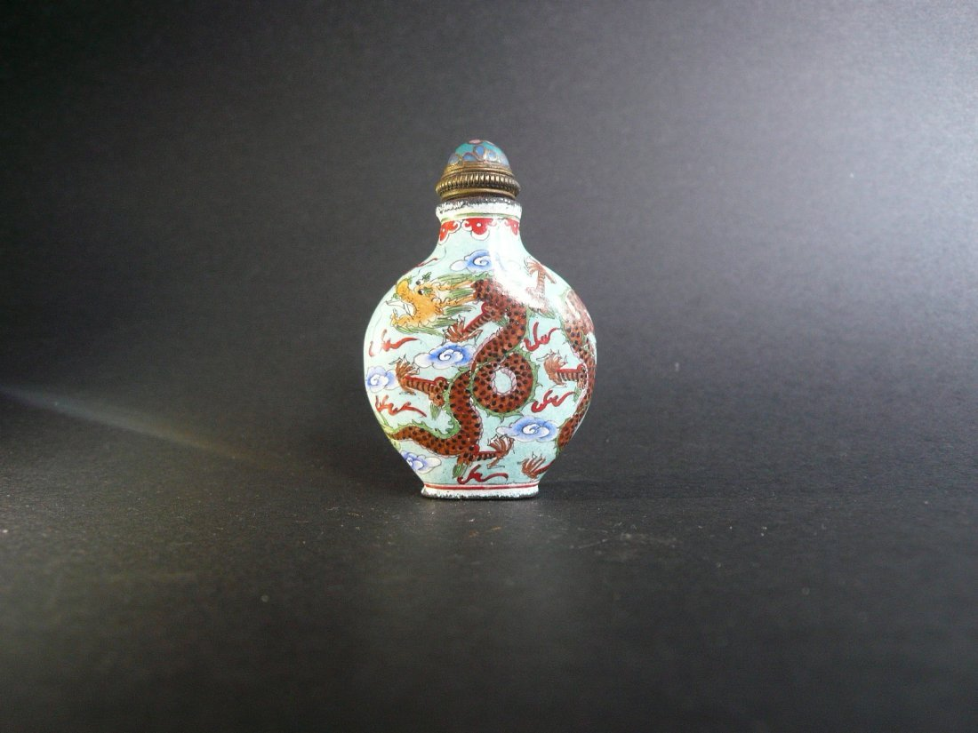 An enamelled on copper dragon snuff bottle