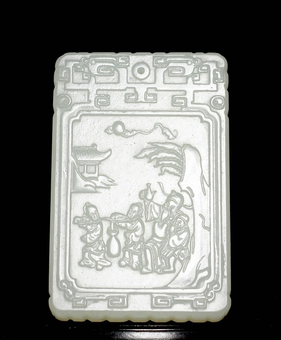 An imperial Qing Dynasty Carved White Jade Plaque