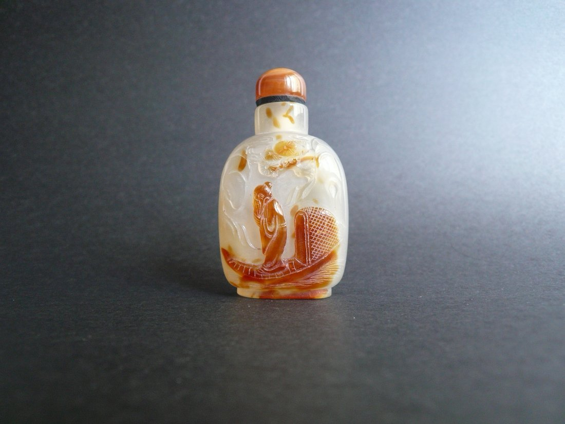 A Qing Dynasty Carved Agate Snuff Bottle