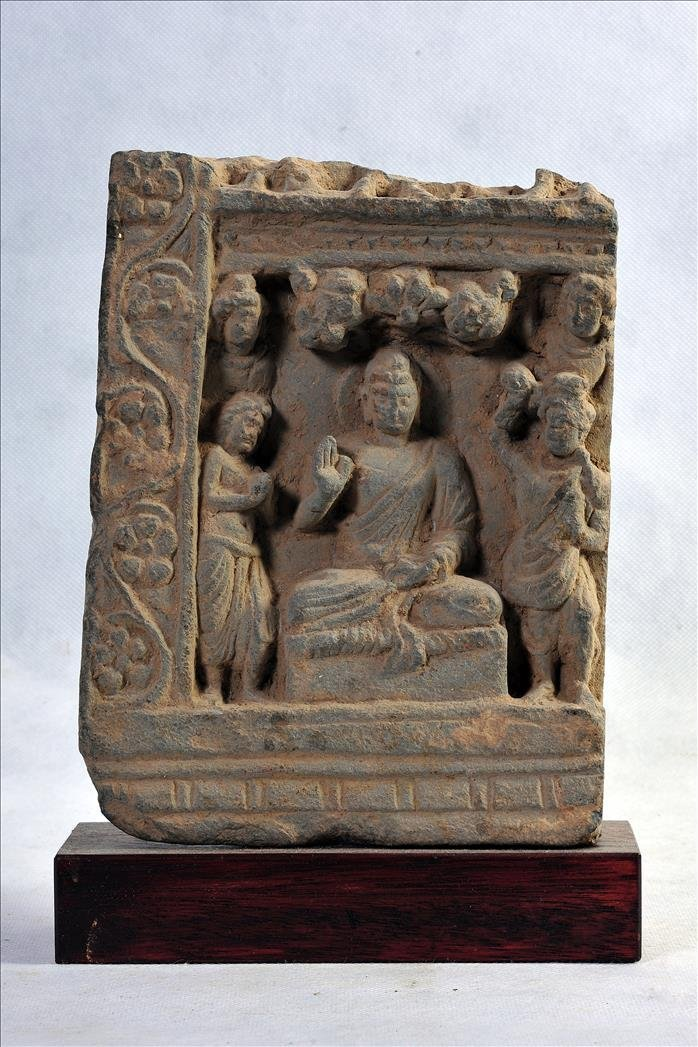 A GANDHARAN SCHIST RELIEF OF SEATED BUDDHA WITH ATTENDA