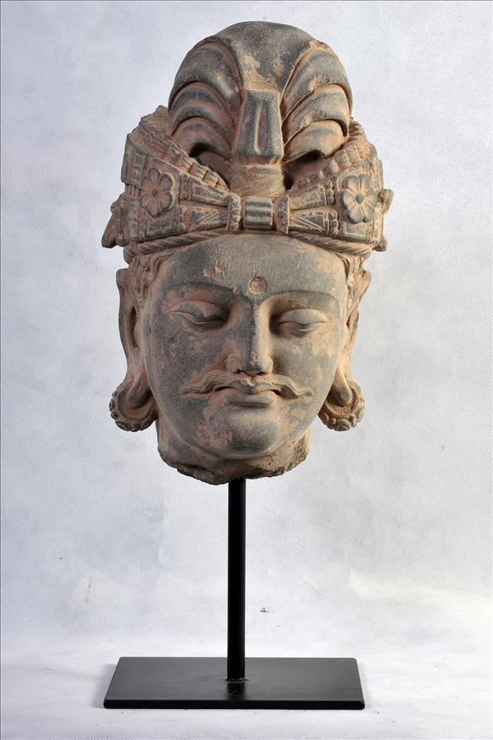 A LARGE GANDHARAN SCHIST BODHISATTVA HEAD