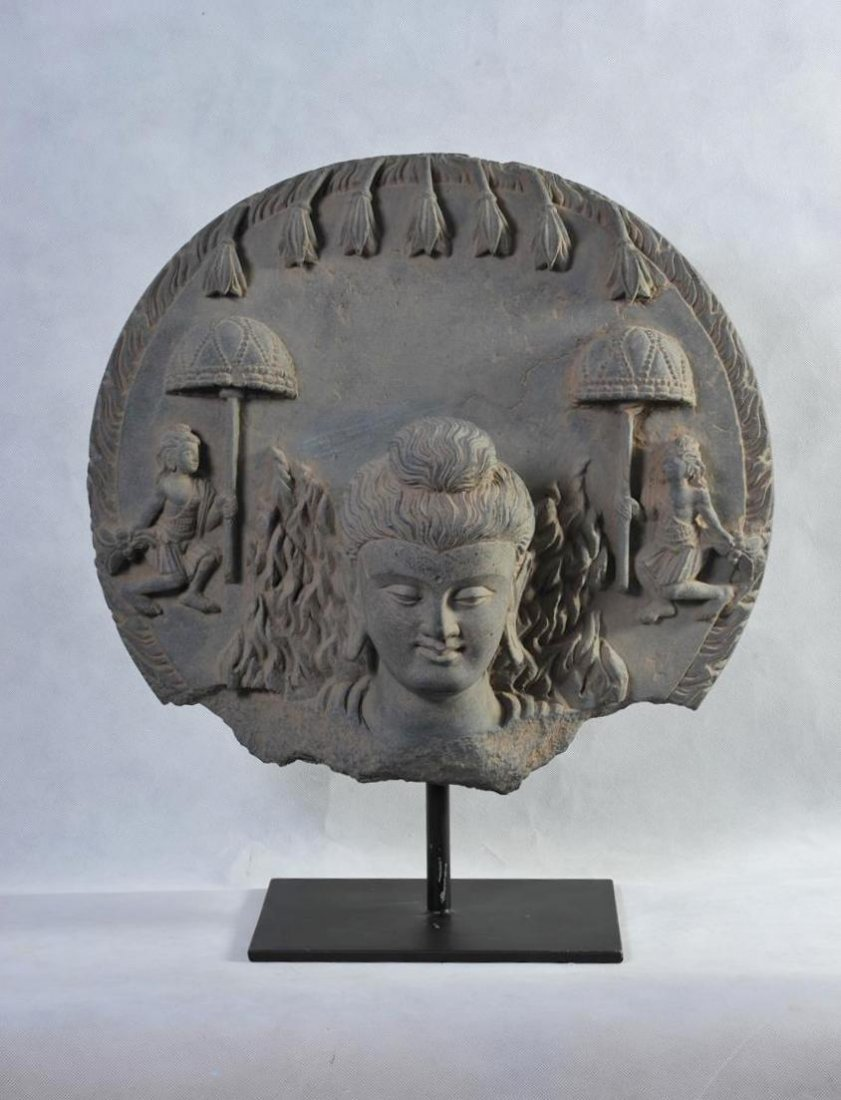 AN IMPORTANT LARGE GANDHARAN SCHIST BUST OF MIRACLE OF