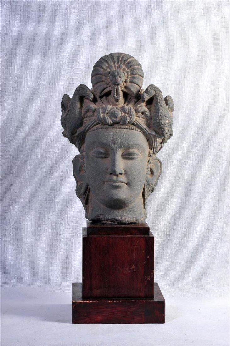 AN EXQUISITE GANDHARAN GREY SCHIST HEAD OF PRINCE SIDDH