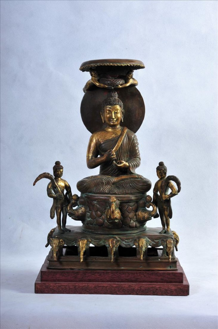 A LARGE GILT COPPER STATUE OF SEATED BUDDHA WITH