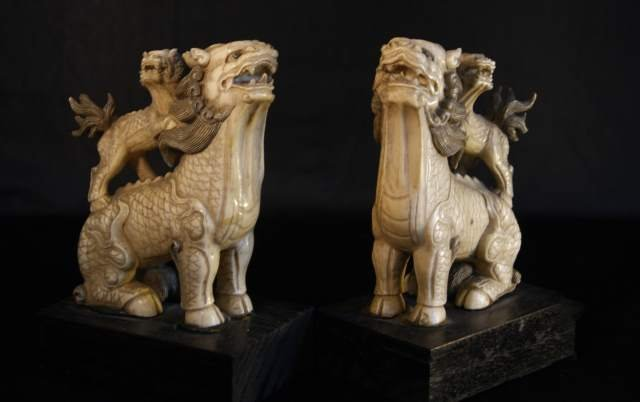 A PAIR OF IMPRESSIVE LARGE MING DYNASTY IVORY FIGURES