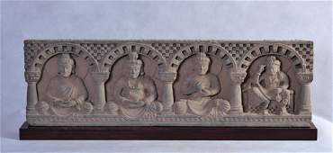 A LARGE GANDHARAN GREY SCHIST STUPA PANEL RELIEF OF 4
