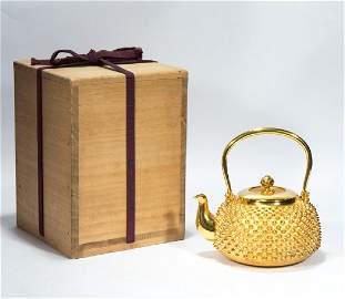 A Gold Teapot with Arare Embossment by Ishiguro Konan