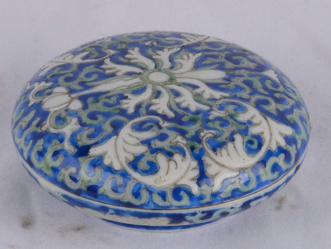 BLUE-GLAZED ROUND BOX AND COVER WITH SWIRLING FLORAL