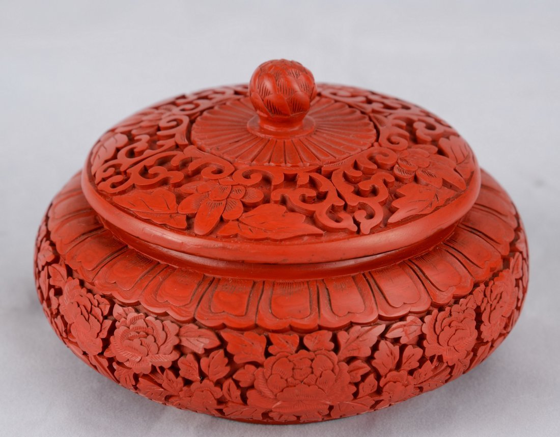 A ROUND CINNABAR LACQUER BOX WITH COVER