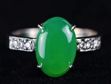 Diamond-Encrusted Platinum Ring With A Green Emerald