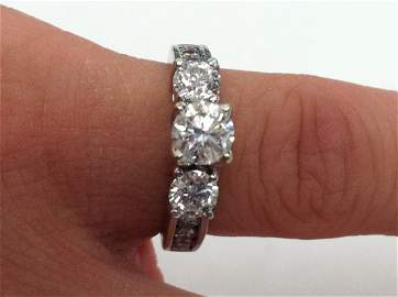 1.54 TOTAL CARAT DIAMOND (.6 CARAT CENTER) AND 14K