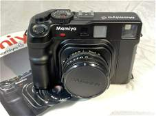 Highend vintage Mamiya 6 rangefinder camera with lens