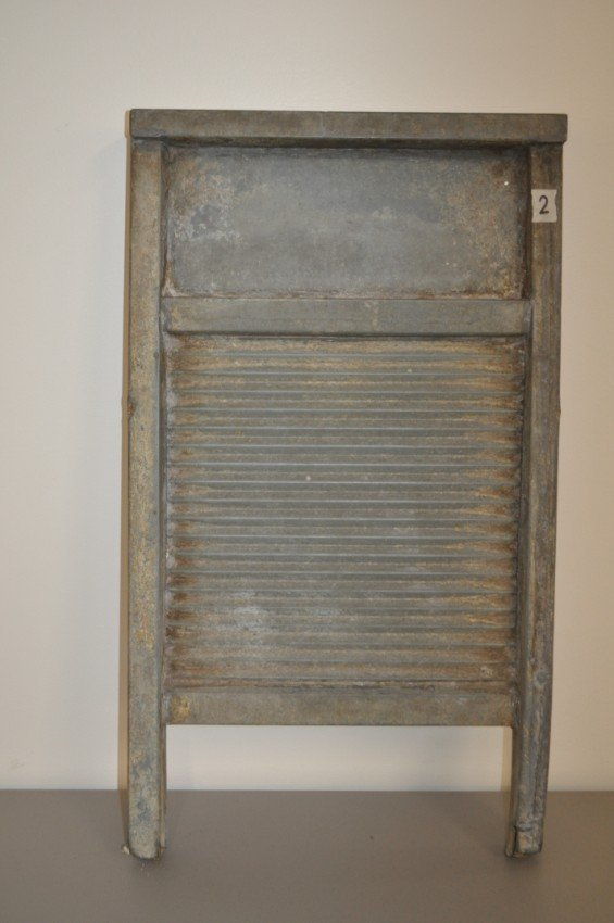 Antique washboard. Tin on wood.