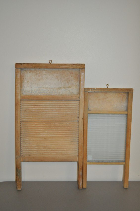 Two antique washboards. One glass, one wood.