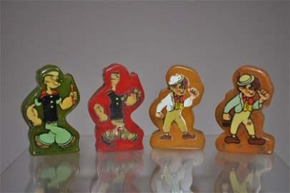 Four Bakelite 1920s Popeye Etc. Toy Pencil Sharpeners