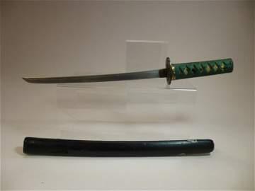 Very fine child's Samurai sword w/embellishments.