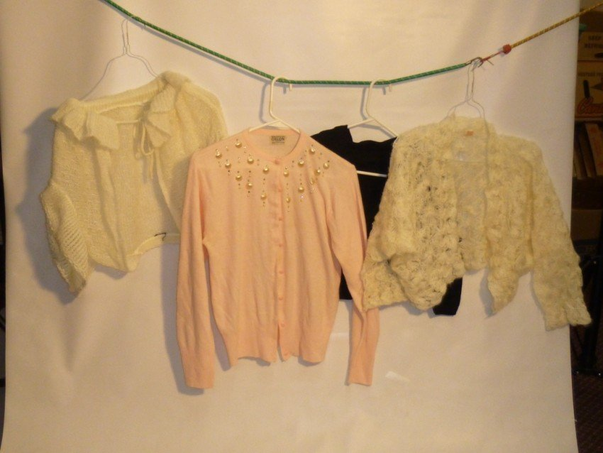 Group lot: Four Vintage sweaters