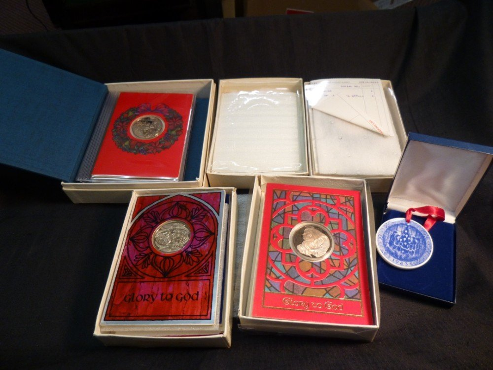 Group lot of Holiday Card Coin sets.