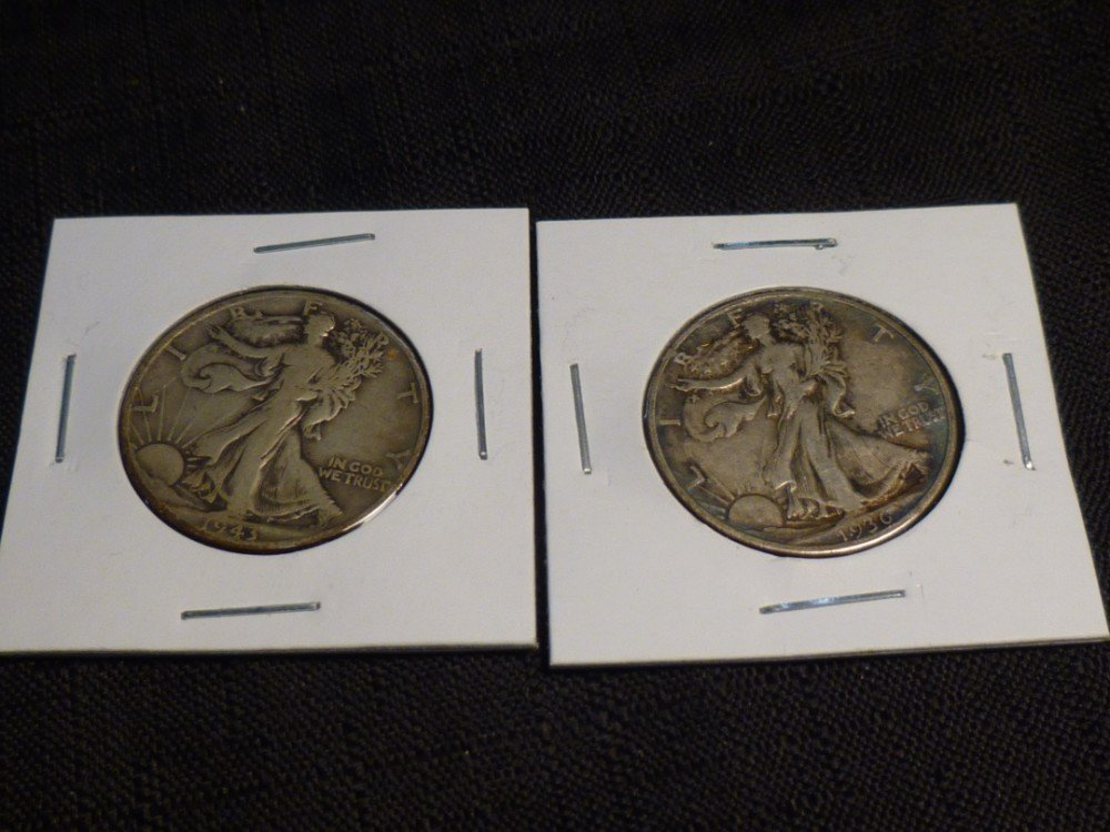 Pair of Walking Liberty half dollar silver coins.