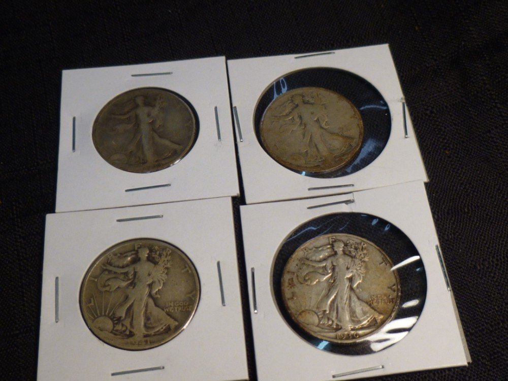 4 Walking Liberty half dollar silver coins.