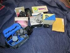 Large box lot of vintage cameras, lenses etc.