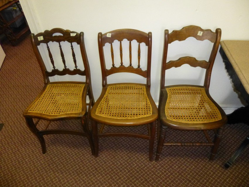 3 cane bottom wooden chairs.