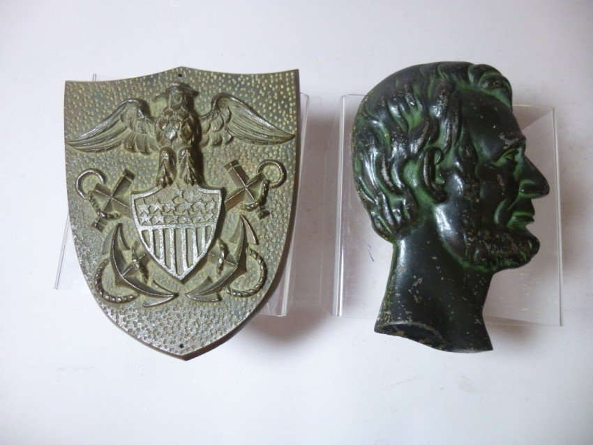 Pair of cast wall plaques
