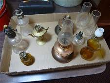Large lot of small vintage oil lamps.