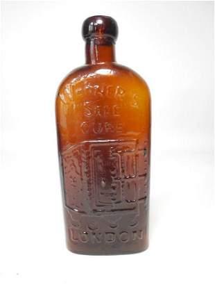 Warner's Safe Cure Glass Bottle Embossed Amber