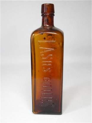 Antique Glass Lash's Bitters Bottle Amber