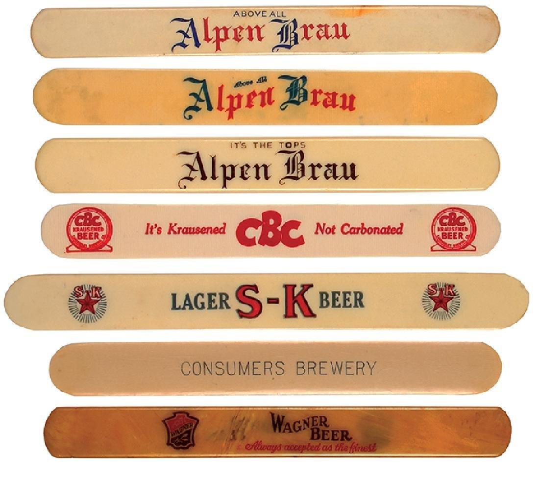 Seven beer foam scrapers