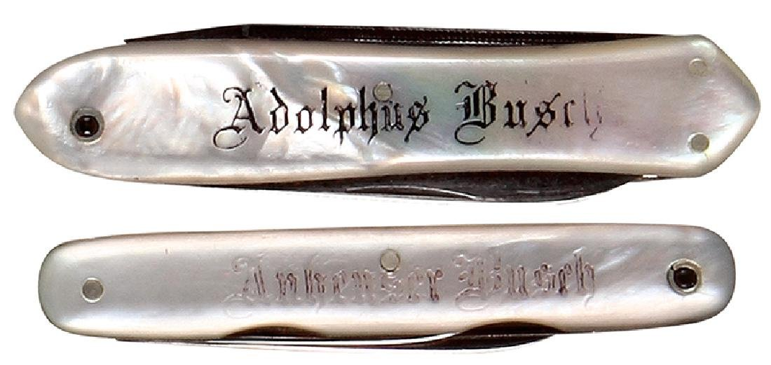 Two Anheuser-Busch pocket knives