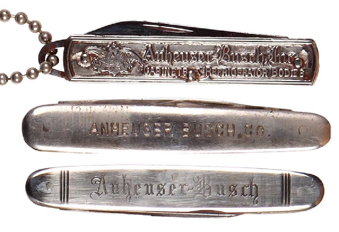 Three Anheuser-Busch pocket knives