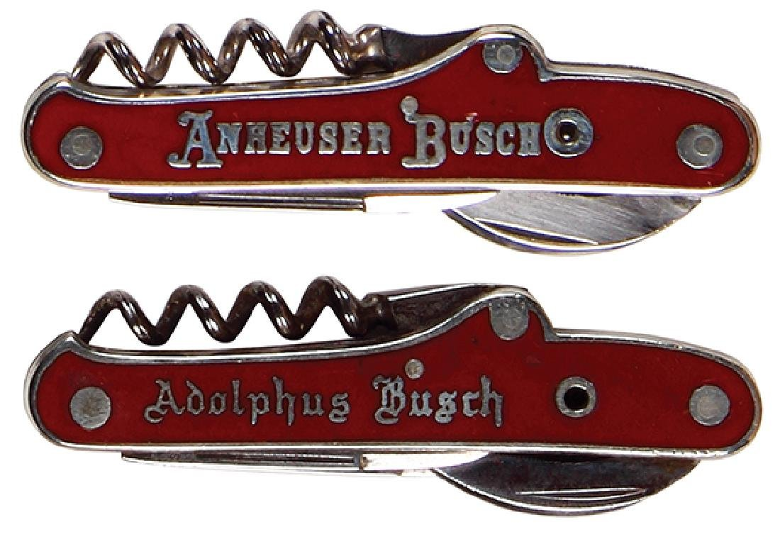 Two Anheuser-Busch enameled pocket knives