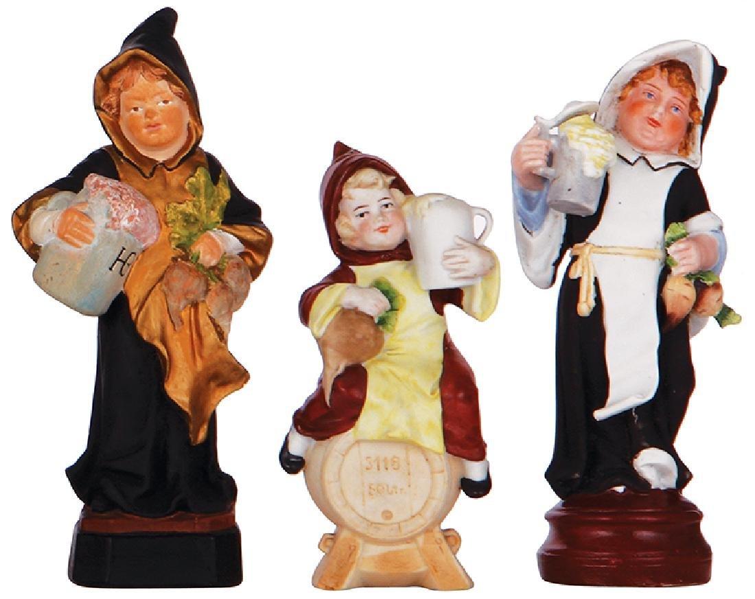 Three Munich Child figurines