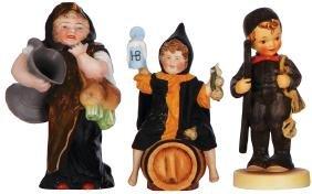 Two Munich Child figurines