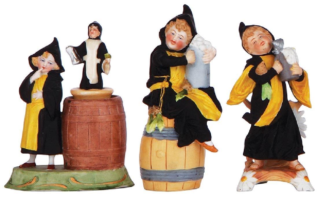 Three porcelain figurines,