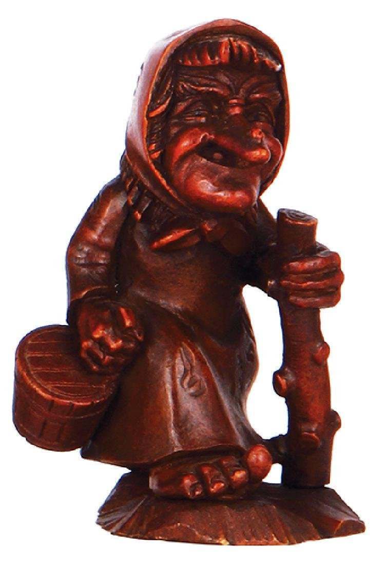 Black Forest wood carved old woman