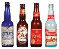 Four Anheuser-Busch bottles