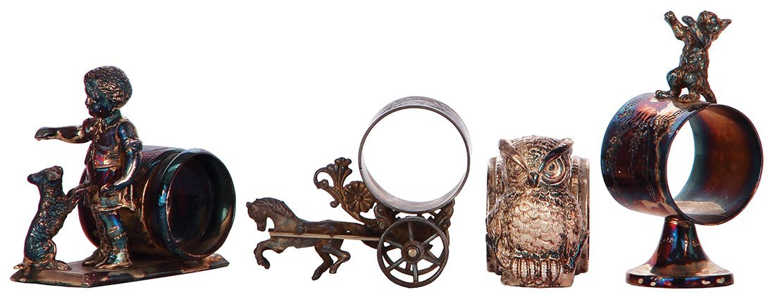 Four figural silver-plated napkin ring animals