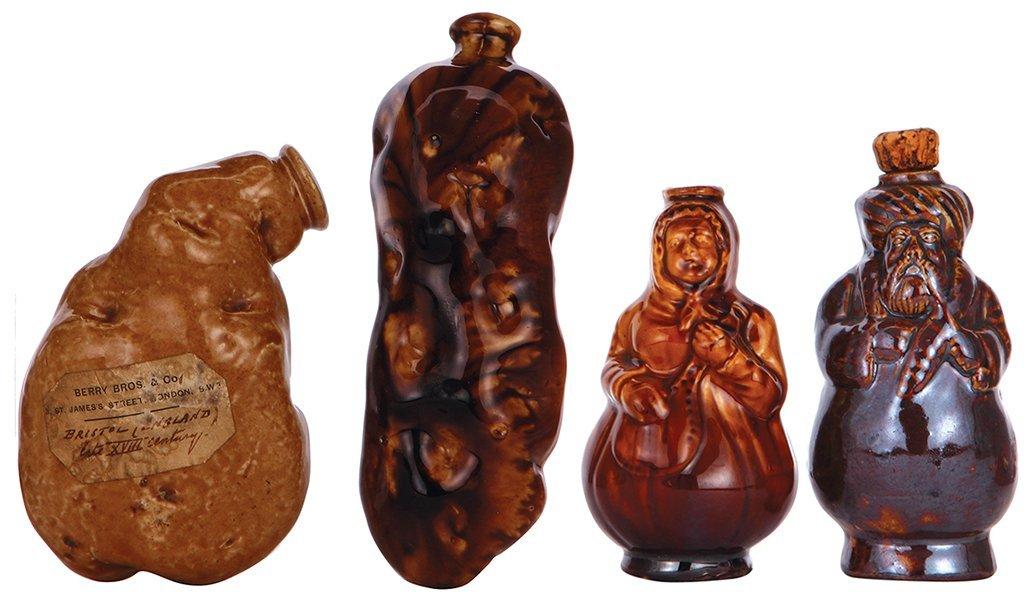 Four stoneware flasks, probably Rockingham