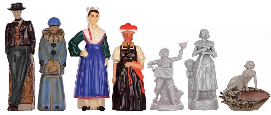 Seven bottles & figurines