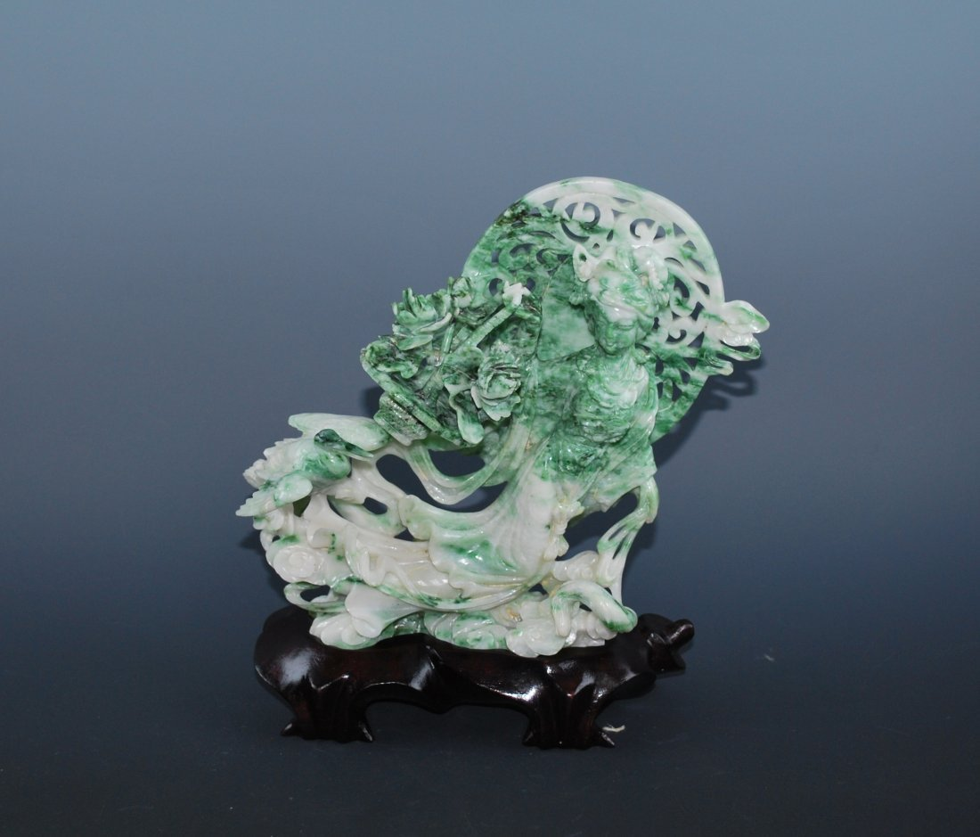 A Finely Carved Jadeite Portrait Of A Lady