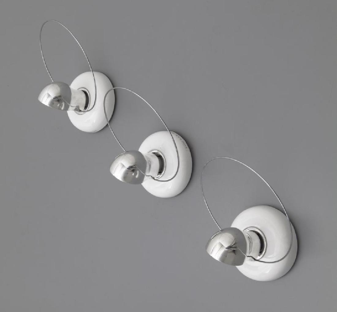 ACHILLE CASTIGLIONI  Tre lampade a parete